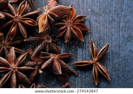 Star anise seeds on the wooden background - stock photo