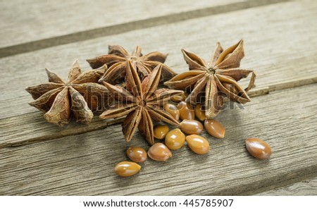Star anise spice fruits on wooden  background closeup - stock photo