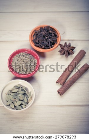 Star anise with cinnamon sticks over black stones background at christmas time - stock photo