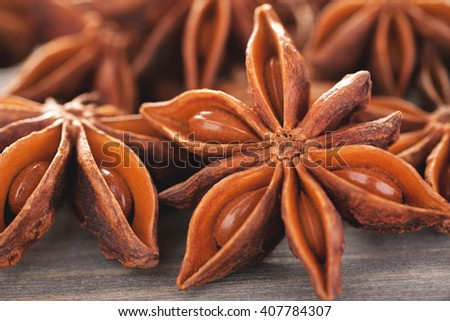 Star anise with seeds on a wooden table closeup macro shot, selective focus - stock photo