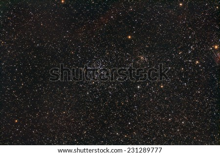 Star cluster on a dark background. Photographed through a telescope. - stock photo