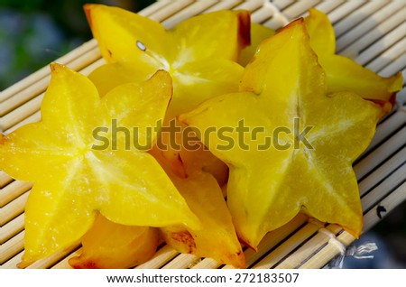 Star fruit - carambola sliced on a wooden board - stock photo