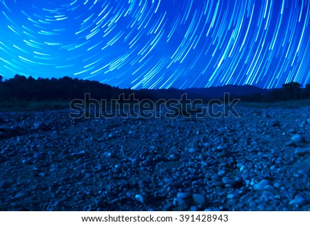 Star moving on the sky and milky way in Indian mountain. - stock photo