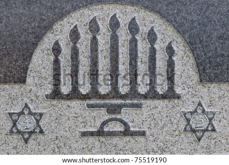 Star of David and menorah on granite tombstone. Old Jewish cemetery in California - stock photo