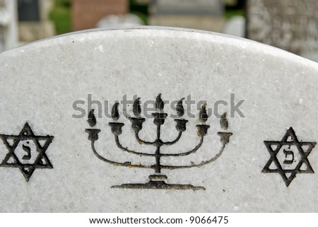 Star of David and menorah on marble tombstone. Old Jewish cemetery in California - stock photo