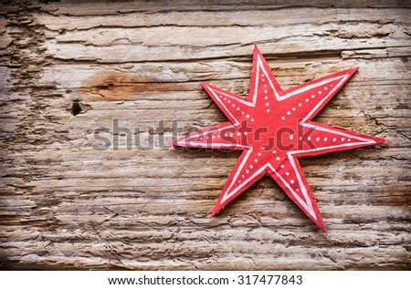 Star - paper Christmas decoration Christmas decoration over grunge background/vintage paper handmade christmas decoration and snow on wooden background with copy space. - stock photo