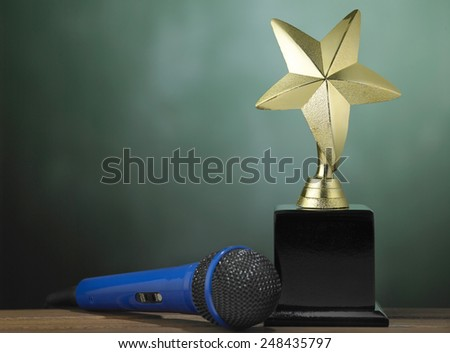 star shape trophy and microphone - stock photo