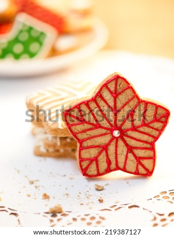 Star shaped Christmas cookies on wooden table - shallow DOF. - stock photo