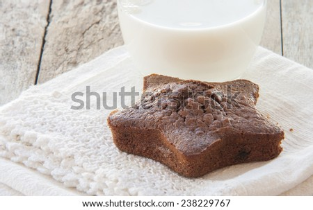 Star-shaped gingerbread cake with glass of milk - stock photo