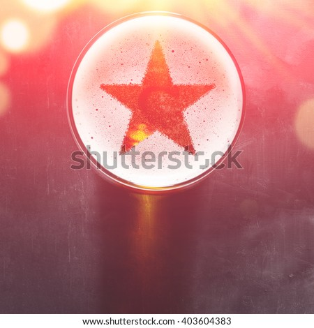 star symbol on foam in glass on black table, view from above - stock photo