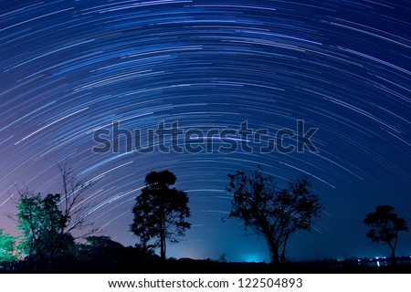 star trail image during the night of the Geminids meteor shower in the Winter of 2012 in nakhonratchasima city at thailand - stock photo