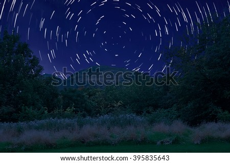 Star trail. Star moving on the sky and milky way. - stock photo