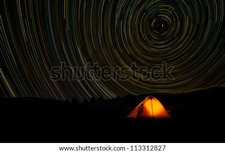 Star Trails Long Exposure At Night - stock photo