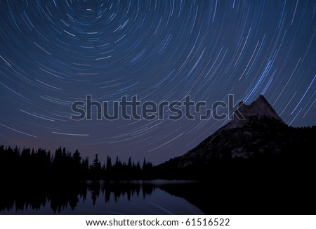 Star Trails over Cathedral Peak. Take at Upper Cathedral Lake in Yosemite National Park - stock photo