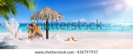Starfish In Relaxation At The Shadow Of Palm Tree In The Tropical Beach - Summer Holiday  - stock photo