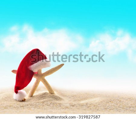 starfish in Santa Claus hat on a beach sand - stock photo