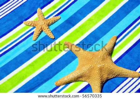 Starfish on Beach towel - stock photo