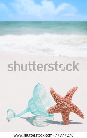 starfish tipping over margarita glass - stock photo