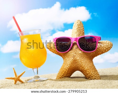 Starfish with sunglasses and cocktail - stock photo