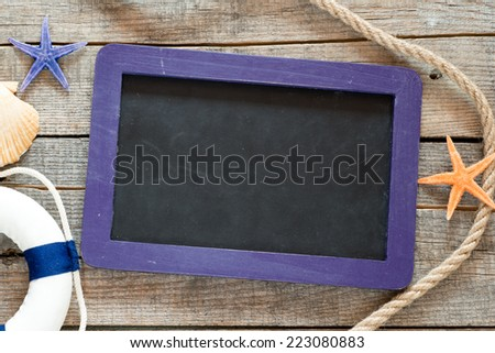 Starfishes and small blackboard. Starfishes and small blackboard with rope and other sea stuff  - stock photo