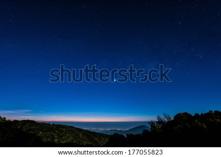 Starry in blue sky night time scene with milky way high iso - stock photo