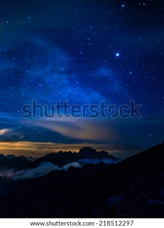 Starry night in mountains - stock photo