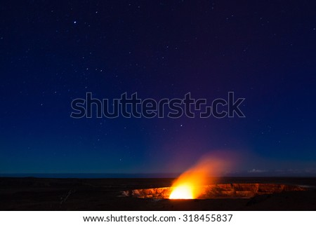Starry night photos of erupting volcano in Hawaii Volcanoes National Park, Big Island, Hawaii. Night photos, multiple minute exposure. Noise visible at 100%. - stock photo