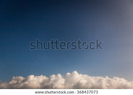 Starry sky and clouds at bottom of image - stock photo