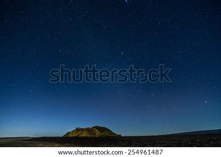 Starry sky from Daniel K Inouye highwayof Hawaii, USA. - stock photo