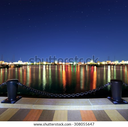 Starry sky over the Lakeside Harbor in Lorain, Ohio photographed from the Mile Long Pier. - stock photo