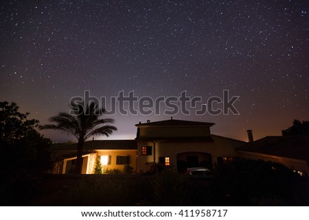 Starry sky over the spanish house in Mallorca - stock photo