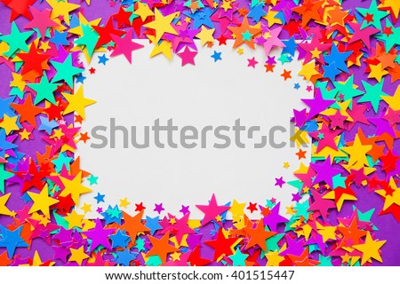 stars confetti on a purple background, frame - stock photo