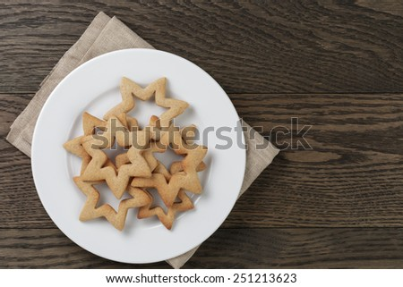 stars cookies for valentines day in plate on wood table - stock photo
