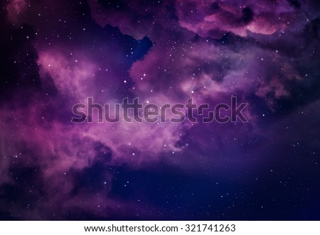 Stars in the night sky,purple background. - stock photo