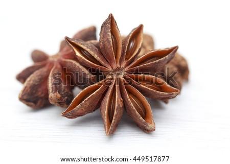 Stars of anise isolated on white background - stock photo