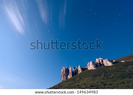 Stars on the sky and moon rising over the mountains - stock photo