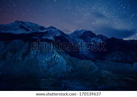 stars over Himalaya mountains - stock photo