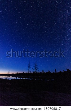 stars over lake - stock photo
