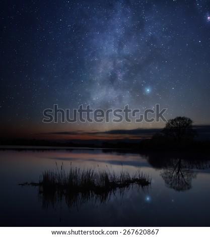 Stars over the lake - stock photo