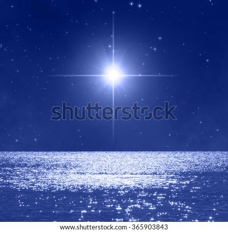 Stars rising over oceans horizon.  No elements of NASA or other third party. - stock photo