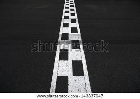 Start and Finish motor race line asphalt on Monaco Montecarlo Grand Prix street circuit - stock photo
