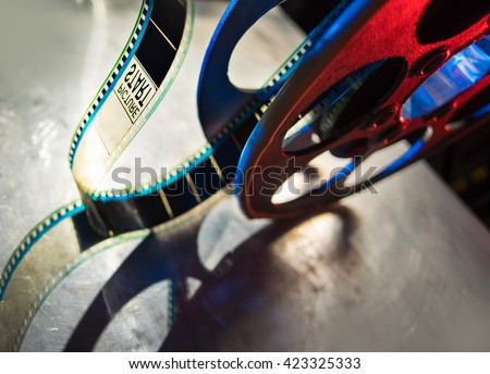 Start 35 mm film shooting film and reel - stock photo