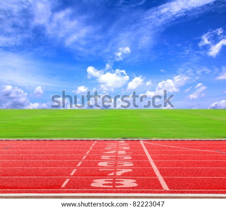 Start or finish position on running track with blue sky - stock photo