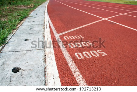 Start point for one three and five thoudsand on running track - stock photo