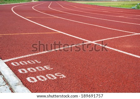 Start point for one three and five thousand on running track - stock photo
