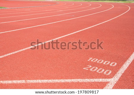 Start point for ten and two thousand on running track - stock photo
