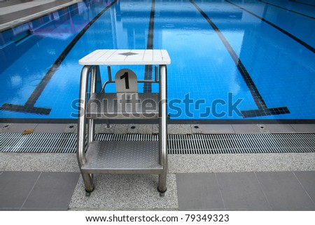 Start position with number 1 in competition swimming pool. - stock photo