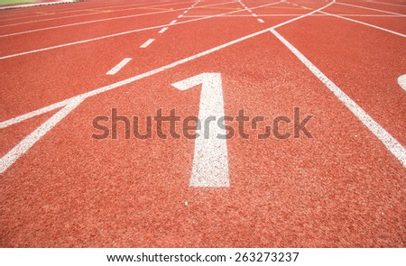 Start track number 1 on red running track. - stock photo