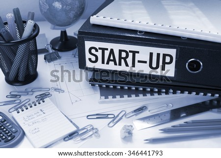 Start up / Business concept in office with papers and files - stock photo