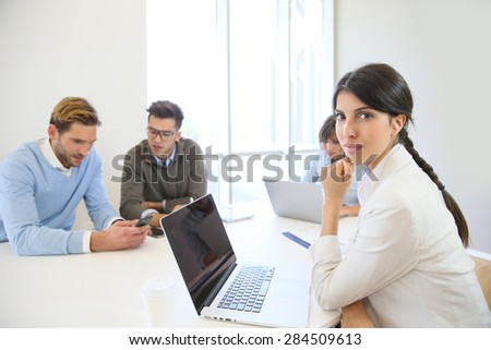 Start-up businesspeople sharing working space - stock photo
